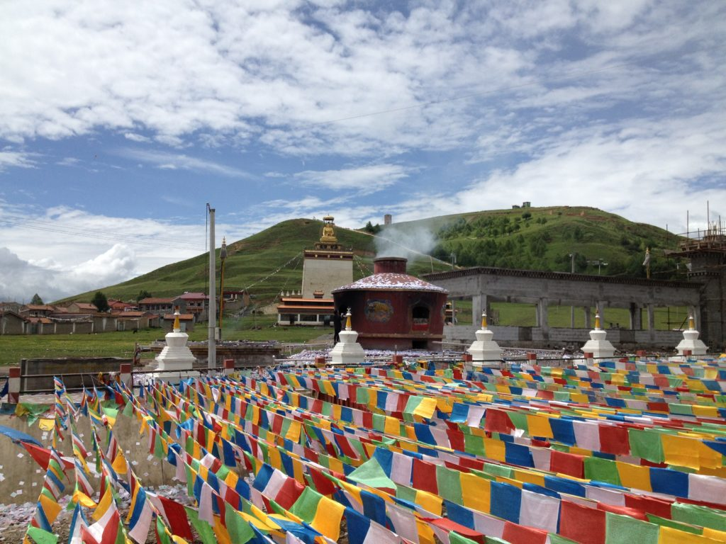 Stupa and prayer flags in Aba
