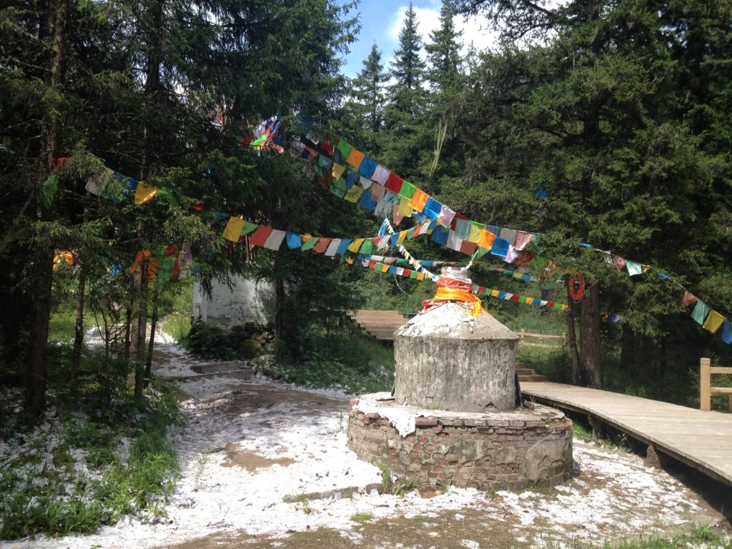 Prayer flags in Erdaohai Lake